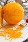 Scratched orange and thin curls of orange peel Stock Images
