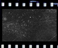 Scratched photo film. A frame of blank photographic film with scratches and damage Royalty Free Stock Photos