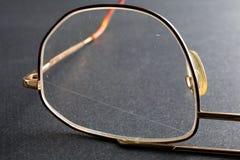 Scratched plastic eyeglasses Stock Image