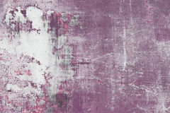 Scratched purple metal surface. Purple scratched metal surface with peeling paint Royalty Free Stock Images