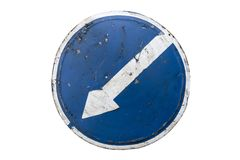 Scratched round blue road sign `Keep Left` isolated on white.  Royalty Free Stock Photo