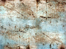 Scratched and rusty. Bluish painted,scratched and rusty metal sheet royalty free stock photography