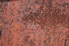 Scratched and rusty orange metal surface Stock Photo