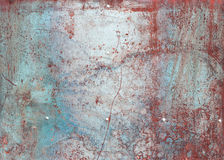 Scratched and rusty red metal surface Stock Photos