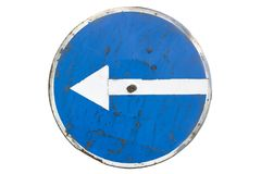 Scratched round blue road sign `Turn Left` isolated on white royalty free stock photography