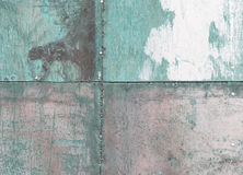 Scratched and rusty turquoise metal surface Stock Photos