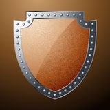 Scratched steel shield Stock Images