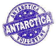 Scratched Textured ANTARCTICA Stamp Seal. ANTARCTICA stamp seal imprint with grunge texture. Designed with rounded rectangle and circles. Blue vector rubber royalty free illustration