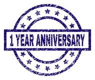 Scratched Textured 1 YEAR ANNIVERSARY Stamp Seal. 1 YEAR ANNIVERSARY stamp seal watermark with grunge texture. Designed with rectangle, circles and stars. Blue Stock Photo