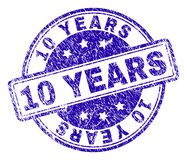 Scratched Textured 10 YEARS Stamp Seal. 10 YEARS stamp seal watermark with grunge texture. Designed with rounded rectangles and circles. Blue vector rubber print stock illustration