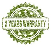 Scratched Textured 2 YEARS WARRANTY Stamp Seal. 2 YEARS WARRANTY stamp seal watermark with rubber print style. Green rubber print of 2 YEARS WARRANTY title with stock illustration