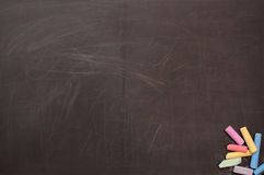 The scratched used up school board. With a colour chalk royalty free stock image