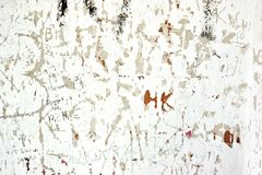 Scratched By Vandals Old Whitewashed Walls With Many Signs Stock Photos