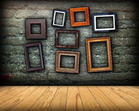 Scratched wall full of wood frames Royalty Free Stock Photo