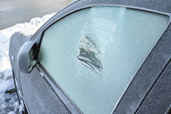 Scratched window car in winter season. Royalty Free Stock Photos