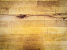 Scratched wooden surface with knots. Yellow, usable as background, decoration or structure illustration Stock Photo