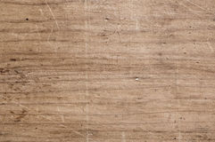 Scratched wooden table. Old scratched wooden table. Texture Stock Photography