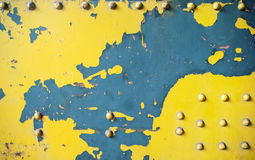 Scratched yellow wall made of metal Royalty Free Stock Photo