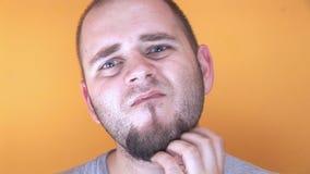 Scratching beard stock footage
