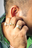 Scratching ear. Male boy scrahing his ear Stock Images