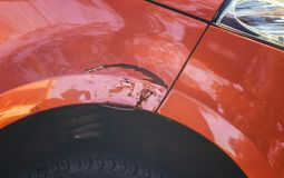 Scratching on the front of the car`s wing in a car repair shop.  Royalty Free Stock Images