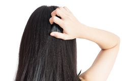 Scratching her head in a woman isolated on white background. Clipping path on white background. Stock Photography