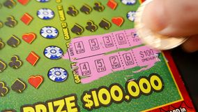 Scratching lottery ticket stock footage