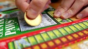 Scratching lottery ticket stock video footage
