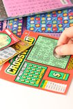 Scratching lottery tickets Royalty Free Stock Photos