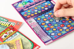 Scratching lottery tickets Royalty Free Stock Images