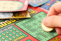 Scratching lottery tickets. Stock Images