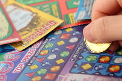 Scratching lottery tickets. Stock Photography