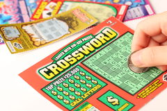 Scratching lottery tickets Stock Photo