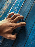 Scratching the table. A shot of a human hand scratching a table top Royalty Free Stock Photos