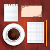 Scratchpad sheets, coffee, business card on table Royalty Free Stock Images