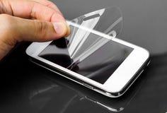 Scratchproof film na smartphone fotografia stock
