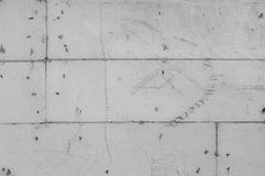 Scratchy greyscale styrofoam wall background with sketches. Fine artistic backgrounds of almost grey resulting from rough construction materials, technical Royalty Free Stock Photo