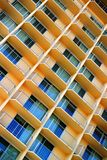 Scratchy Hotel Facade. Facade of a tall yellow hotel building Royalty Free Stock Image
