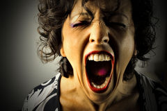 Scream. Portrait of young and shocked woman screaming stock photo
