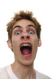 Scream. A shocking surprise to a young man screaming Stock Images