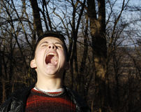 The scream. Grimace. The shrill scream I Royalty Free Stock Photography