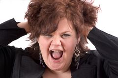 Scream!. Big woman with her hands in her hair face in a scream stock image