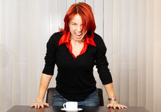 Scream!!. Young pretty caucasian businesswoman screaming in the office Royalty Free Stock Image