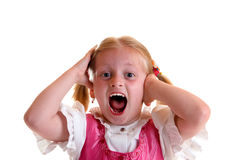 Scream. Young child screams and looks into camera Stock Image