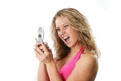 Scream blond. The enthusiastic girl has read through the message in a mobile phone Royalty Free Stock Photo