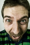 Scream of funny excited man. Close-up portrait of man with funny face screaming Royalty Free Stock Images