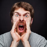 Scream of man making an announcement. Scream of excited man making an announcement royalty free stock images