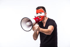 Scream on megaphone Austrian football fan in game supporting of Austria national team Royalty Free Stock Images