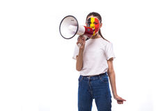 Scream on megaphone Belgian football fan in game supporting of Belgium national team Stock Photos