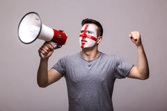 Scream on megaphone Englishman football fan in game supporting of England national team Stock Photo